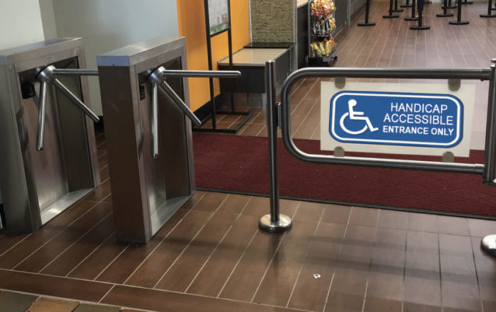 Handicap accessable security gate access sytem. Hayward Turnstiles ADA swing gate entrance for lobby, library, office